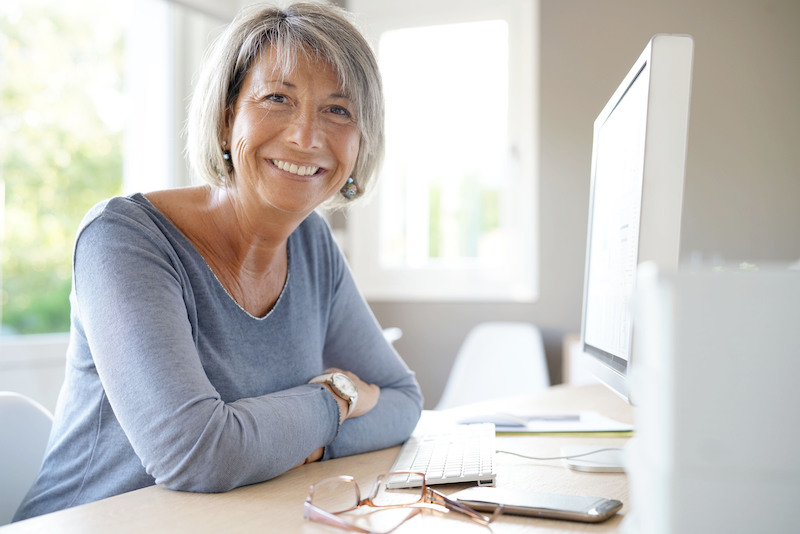 Businesswoman Working on Desktop